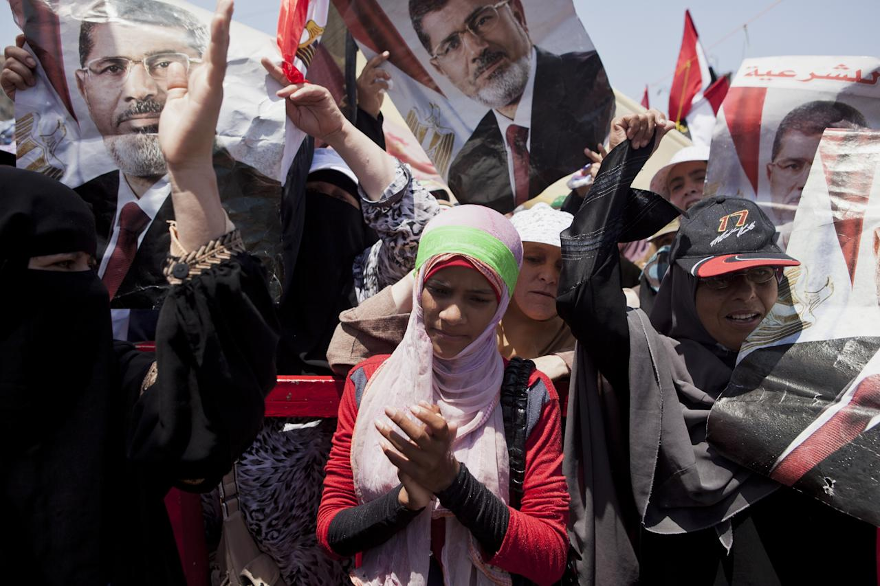 CAIRO, EGYPT - JULY 26: Supporters of deposed Egyptian President Mohammed Morsi take part in a demonstration at the Rabaa al-Adweya mosque in the district of Nasr City on July 26, 2013 in Cairo, Egypt. Morsi supporters gathered to protest the overthrow of Morsi, Egypt's first democratically elected leader, by the Egyptian Armed Forces. Muslim Brotherhood leaders called for pro-Morsi protesters to return to the streets on Friday in response to a speech made by General Ahmed Fattah al-Sissi, the Chief of Egypt's Armed Forces, who called for mass anti-Morsi protests across Egypt against 'violence and terrorism' and in support of the military's overthrow of Morsi. (Photo by Ed Giles/Getty Images)