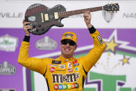Kyle Busch celebrates with the guitar trophy after winning the NASCAR Xfinity Series auto race at Nashville Superspeedway on Saturday, June 19, 2021, in Lebanon, Tenn. (AP Photo/Mark Humphrey)