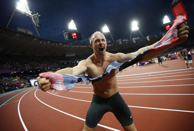 Germany's Robert Harting celebrates after winning the men's discus throw final during the London 2012 Olympic Games at the Olympic Stadium August 7, 2012. Harting won gold ahead of Iran's Ehsan Hadadi who took silver and Estonia's Gerd Kanter who won bronze. REUTERS/Kai Pfaffenbach (BRITAIN - Tags: SPORT ATHLETICS OLYMPICS TPX IMAGES OF THE DAY)