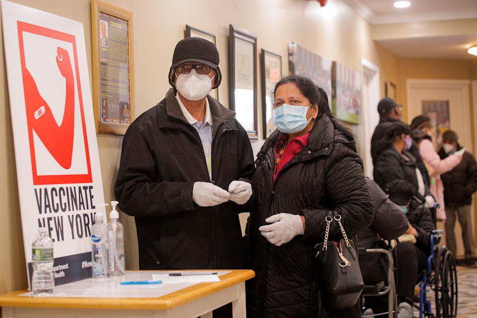 People wait in line to receive Pfizer's coronavirus disease (COVID-19) vaccine at a pop-up community vaccination center at the Gateway World Christian Center in Valley Stream, New York on February 23, 2021.  (Brendan McDermid/Reuters)