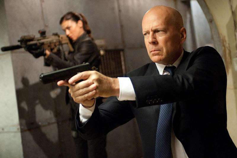"""This film image released by Paramount Pictures shows Adrianne Palicki, left, and Bruce Willis in a scene from """"G.I. Joe: Retaliation."""" (AP Photo/Paramount Pictures, Jaimie Trueblood)"""