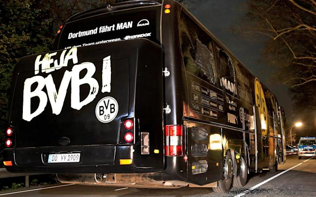 The Dortmund bus after it was struck by three explosives - EPA