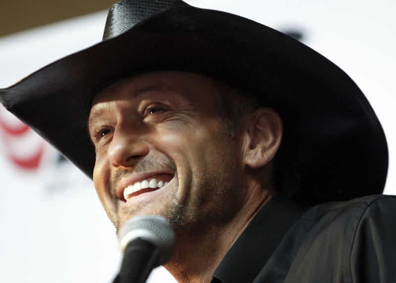 Country music star Tim McGraw speaks during a news conference at the Country Music Hall of Fame and Museum on Monday, May 21, 2012, in Nashville, Tenn. McGraw announced he has signed a multi-album deal with Big Machine Records, officially ending his rocky relationship with his only previous label, Curb Records. (AP Photo/Mark Humphrey)