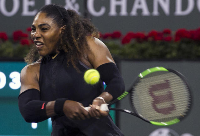 Serena Williams returns a shot to opponent and sister Venus Williams during the third round of the BNP Paribas Open tennis tournament at the Indian Wells Tennis Garden in Indian Wells, Calif., Monday, March 12, 2018. (AP Photo/Crystal Chatham)
