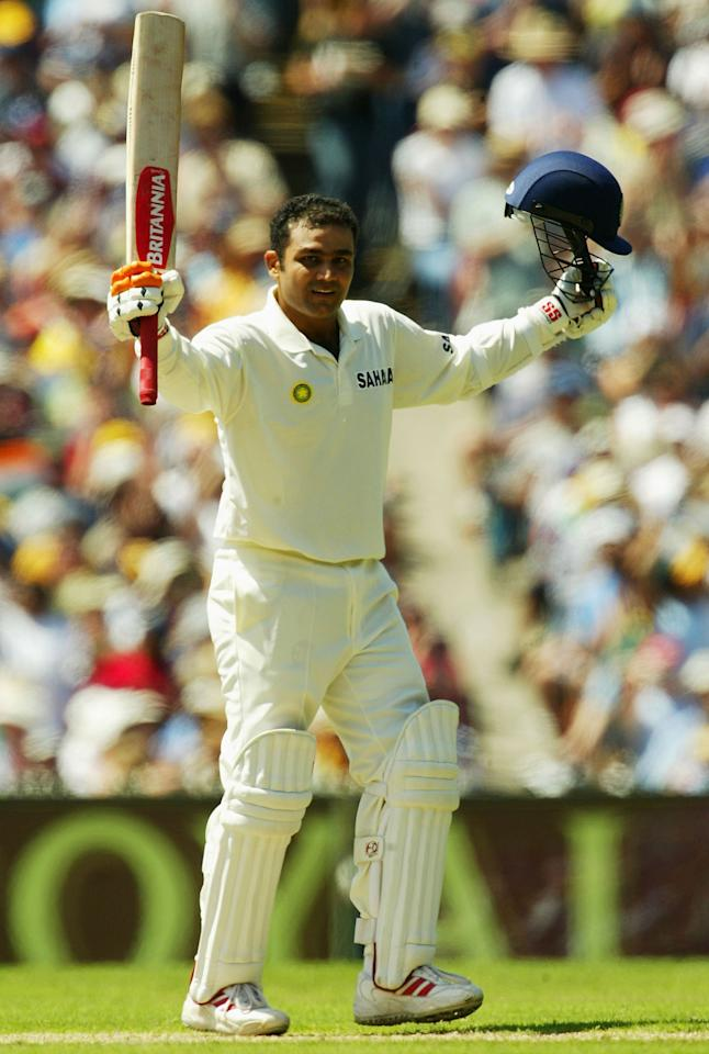 MELBOURNE, AUSTRALIA - DECEMBER 26:  Virender Sehwag of India reaches 100 during day one of the Boxing Day 3rd Test between Australia and India at the MCG on December 26, 2003 in Melbourne, Australia.  (Photo by Hamish Blair/Getty Images)