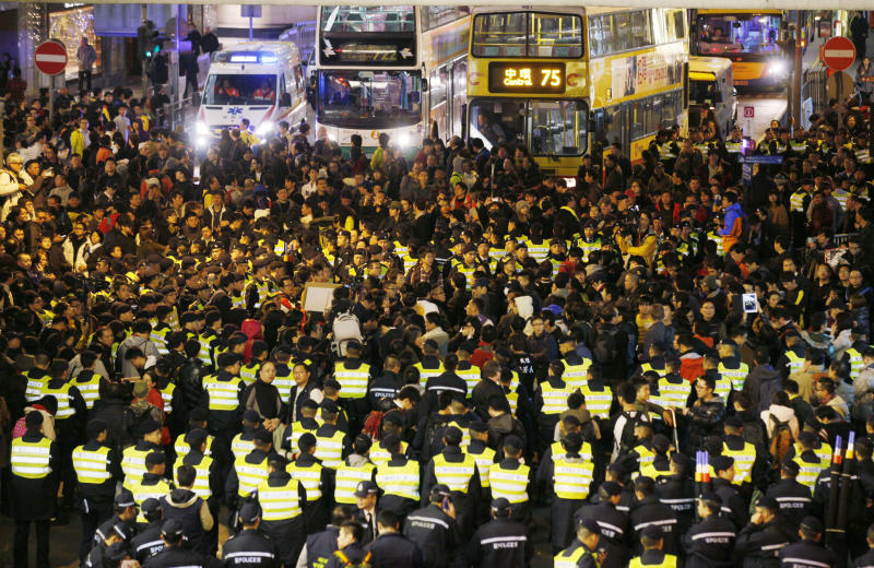 Tens of thousands protest against Hong Kong leader