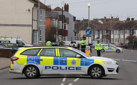 Police at the scene where the two women were shot dead at a house in St Leonards, East Sussex - Credit: Gareth Fuller/PA