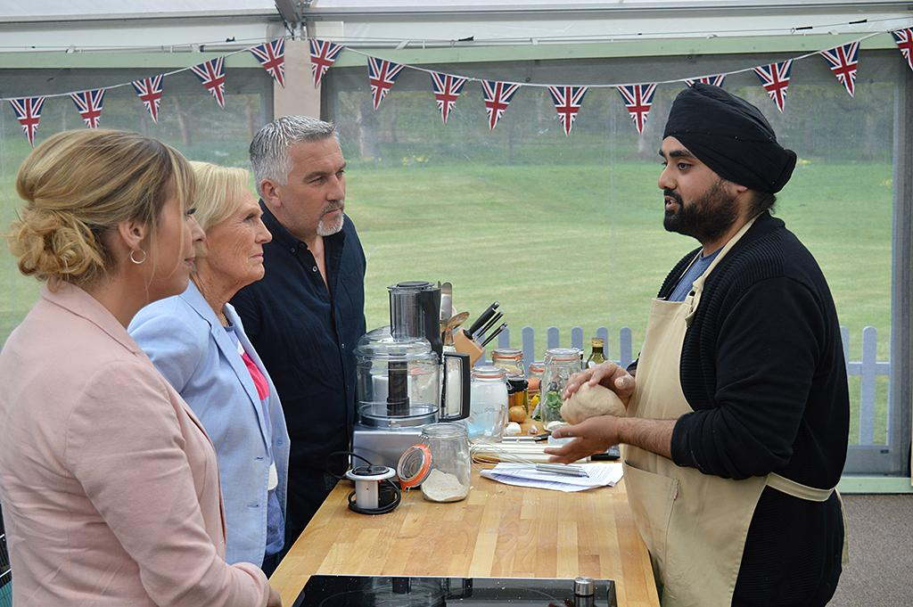 <p>Mel, Mary Berry, Paul Hollywood and contestant Rav on PBS's <i>The Great British Baking Show</i>.<br /><br />(Photo Credit: PBS) </p>