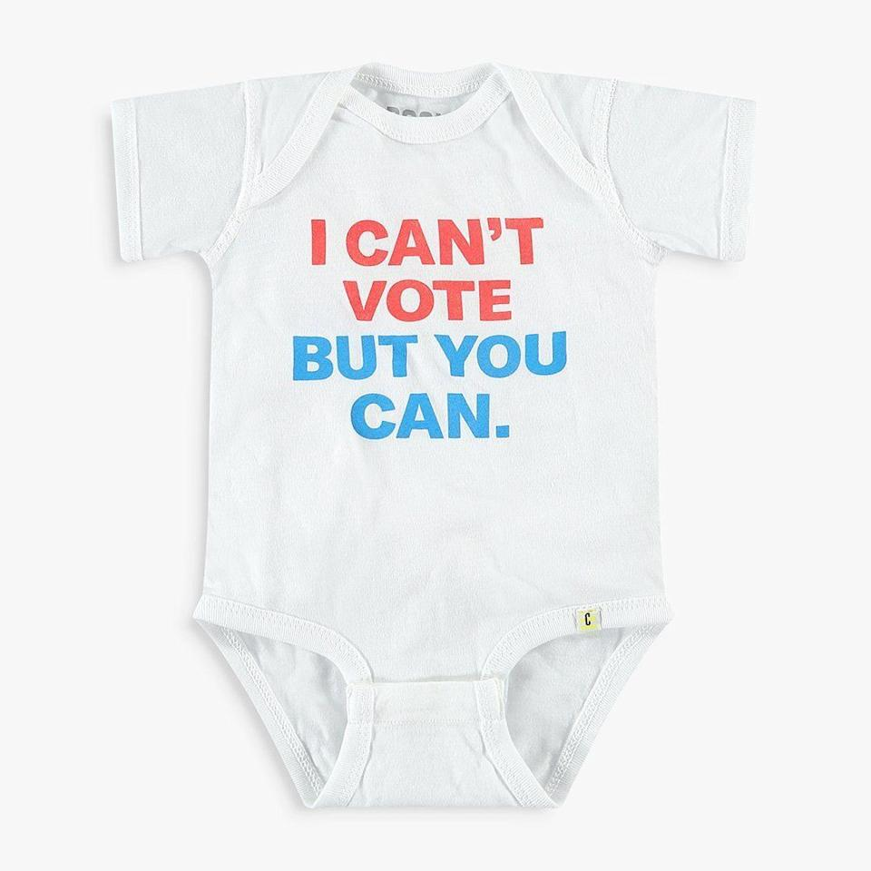 """Get the<a href=""""https://store.crooked.com/products/i-cant-vote-but-you-can-kids-apparel"""" target=""""_blank"""" rel=""""noopener noreferrer"""">I can't vote but you can onesie from Crooked</a> for $22."""
