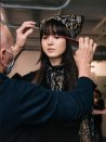 """<p>Garren solely used products from sustainable luxury sister brand to R+Co, R+Co BLEU to create the sleek and voluminous hair looks that were also inspired by the '60s. For the sleek shine of the swooped straight hair, he applied the <a href=""""https://www.saksfifthavenue.com/product/r-co-bleu-magnifier-thickening-spray-0400013806714.html?site_refer=CSE_GGLPLA:Womens_Beauty:R%2BCo+Bleu&country=US¤cy=USD&CSE_CID=G_Saks_PLA_US_Beauty:All+Beauty&gclid=Cj0KCQiA7NKBBhDBARIsAHbXCB5u_uQbgVrr2tYGCwdAMIdzTZrkUOC7sOJckEj-4_6YNedzPLUblRIaAjB-EALw_wcB&gclsrc=aw.ds"""" rel=""""nofollow noopener"""" target=""""_blank"""" data-ylk=""""slk:Magnifier Thickening Spray"""" class=""""link rapid-noclick-resp"""">Magnifier Thickening Spray</a> to damp hair, for maximum volume, he blows dry the hair upside down and then applies <a href=""""https://www.saksfifthavenue.com/product/r-co-bleu-lifestyler-volume--amp--texture-spray-0400013806729.html?site_refer=CSE_GGLPLA:Womens_Beauty:R%2BCo+Bleu&country=US¤cy=USD&CSE_CID=G_Saks_PLA_US_Beauty:All+Beauty&gclid=Cj0KCQiA7NKBBhDBARIsAHbXCB6Znt2Ch6cTrF-gH6IFpbWWuWM52FZC7TWEiDypYMf6X_oIsQi5AWcaArE_EALw_wcB&gclsrc=aw.ds"""" rel=""""nofollow noopener"""" target=""""_blank"""" data-ylk=""""slk:Lifesaver Volume & Texture Spray"""" class=""""link rapid-noclick-resp"""">Lifesaver Volume & Texture Spray</a> for volumized texture. For thick, curly hair Garren recommends using the <a href=""""https://www.saksfifthavenue.com/product/r-co-bleu-surreal-styling-serum-13806719.html"""" rel=""""nofollow noopener"""" target=""""_blank"""" data-ylk=""""slk:Surreal Styling Serum"""" class=""""link rapid-noclick-resp"""">Surreal Styling Serum </a>in wet hair and then diffusing, he then adds the <a href=""""https://www.saksfifthavenue.com/product/r-co-bleu-optical-illusion-smoothing-oil-0400013806720.html?site_refer=CSE_GGLPLA:Womens_Beauty:R%2BCo+Bleu&country=US¤cy=USD&CSE_CID=G_Saks_PLA_US_Beauty:All+Beauty&gclid=Cj0KCQiA7NKBBhDBARIsAHbXCB72rpbNPsWP0_vcWrmfgs9czwa91Zkra81-hTmMkqn35q3nGSALc5oaAlQ1EALw_wcB&gclsrc=aw.ds"""" rel=""""nofollow noopener"""" target=""""_blank"""