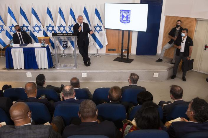 FILE - In this May 19, 2021, file photo, Israeli Prime Minister Benjamin Netanyahu speaks during a briefing to ambassadors to Israel at the Hakirya military base in Tel Aviv, Israel. Netanyahu's political career seemed all but over, but now, as Israel and Gaza's Hamas rulers wage war, Netanyahu's fortunes have changed dramatically. His rivals' prospects have crumbled, Netanyahu is back in his comfortable role as Mr. Security, and the country could soon be headed for yet another election campaign. (AP Photo/Sebastian Scheiner, Pool, File)