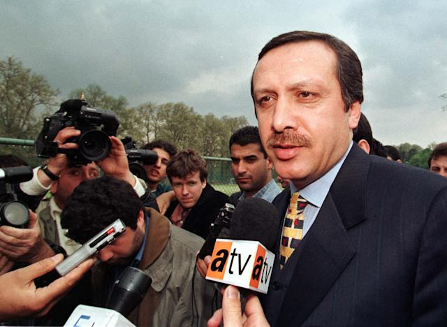 "<p>Istanbul Mayor Tayyip Erdogan is mobbed by journalists while he inspects a public park in the north of Istanbul April 21, 1998. The state security court in the southeastern Turkish city of Diyarbakir sentenced mayor Erdogan, one of the most prominent Islamists, to 10 months in jail for ""enciting hatred"" in an address to Islamists supporters last year in the nearby town of Siirt. Erdogan dismisssed the verdict and said his lawyers had launched an appeal. (Fatih Saribas/Reuters) </p>"