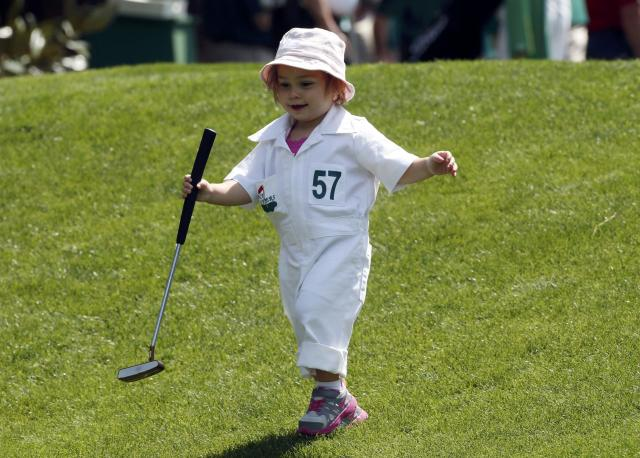 South African golfer Louis Oosthuizen's daughter Sophia runs down the first fairway during the Par 3 Contest ahead of the Masters golf tournament at the Augusta National Golf Club in Augusta, Georgia April 9, 2014. REUTERS/Mike Segar (UNITED STATES - Tags: SPORT GOLF)