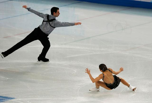 Marissa Castelli stumbles as she and Simon Shnapir of the United States compete during the Team Pairs Free Skating Program at the Sochi 2014 Winter Olympics, February 8, 2014. REUTERS/David Gray (RUSSIA - Tags: SPORT FIGURE SKATING SPORT OLYMPICS)