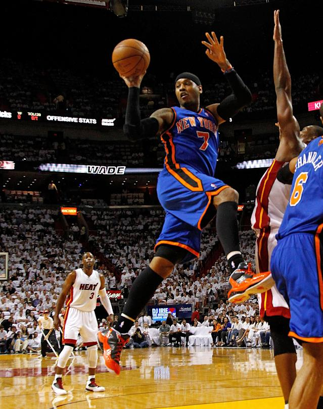 MIAMI, FL - APRIL 30: Carmelo Anthony #7 of the New York Knicks passes during Game Two of the Eastern Conference Quarterfinals in the 2012 NBA Playoffs against the Miami Heatat American Airlines Arena on April 30, 2012 in Miami, Florida. NOTE TO USER: User expressly acknowledges and agrees that, by downloading and/or using this Photograph, User is consenting to the terms and conditions of the Getty Images License Agreement. (Photo by Mike Ehrmann/Getty Images)