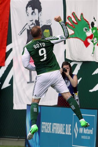 Portland Timbers' Kris Boyd (9) celebrates after scoring in the first half during an MLS soccer game with the Seattle Sounders, Sunday, June 24, 2012, in Portland, Ore. (AP Photo/Rick Bowmer)