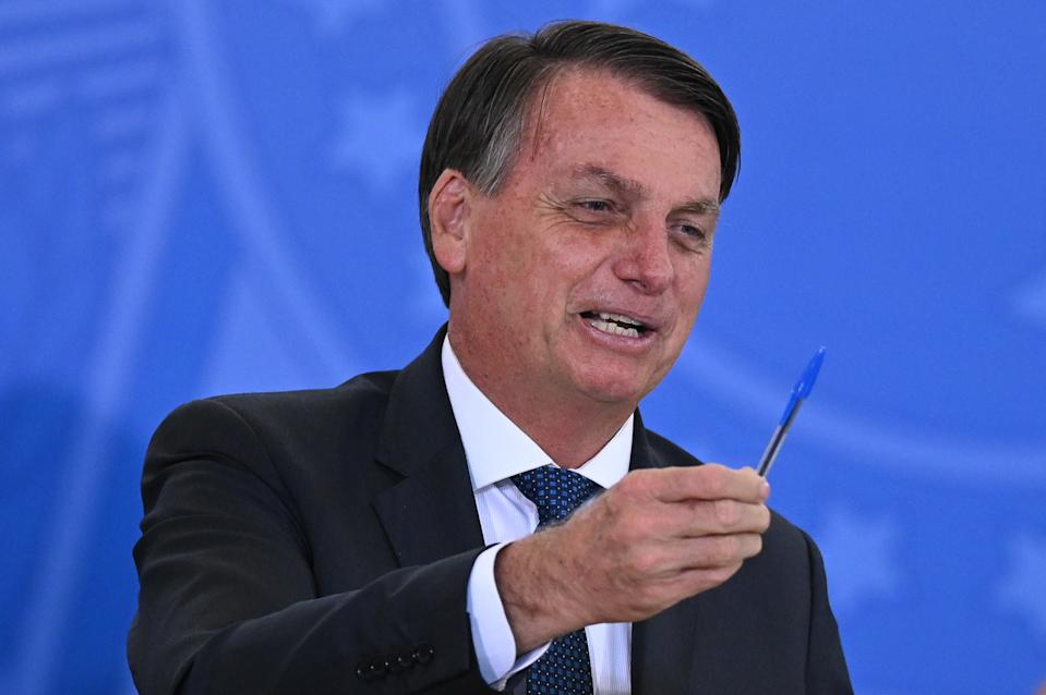 Brazil's President Jair Bolsonaro hods his pen during the swearing-in ceremony of the Brazil's Tourism Minister Gilson Machado, amidst the Coronavirus (COVID - 19) pandemic at Planalto Palace on December 17, 2020 in Brasilia. (Photo by Andre Borges/NurPhoto via Getty Images)