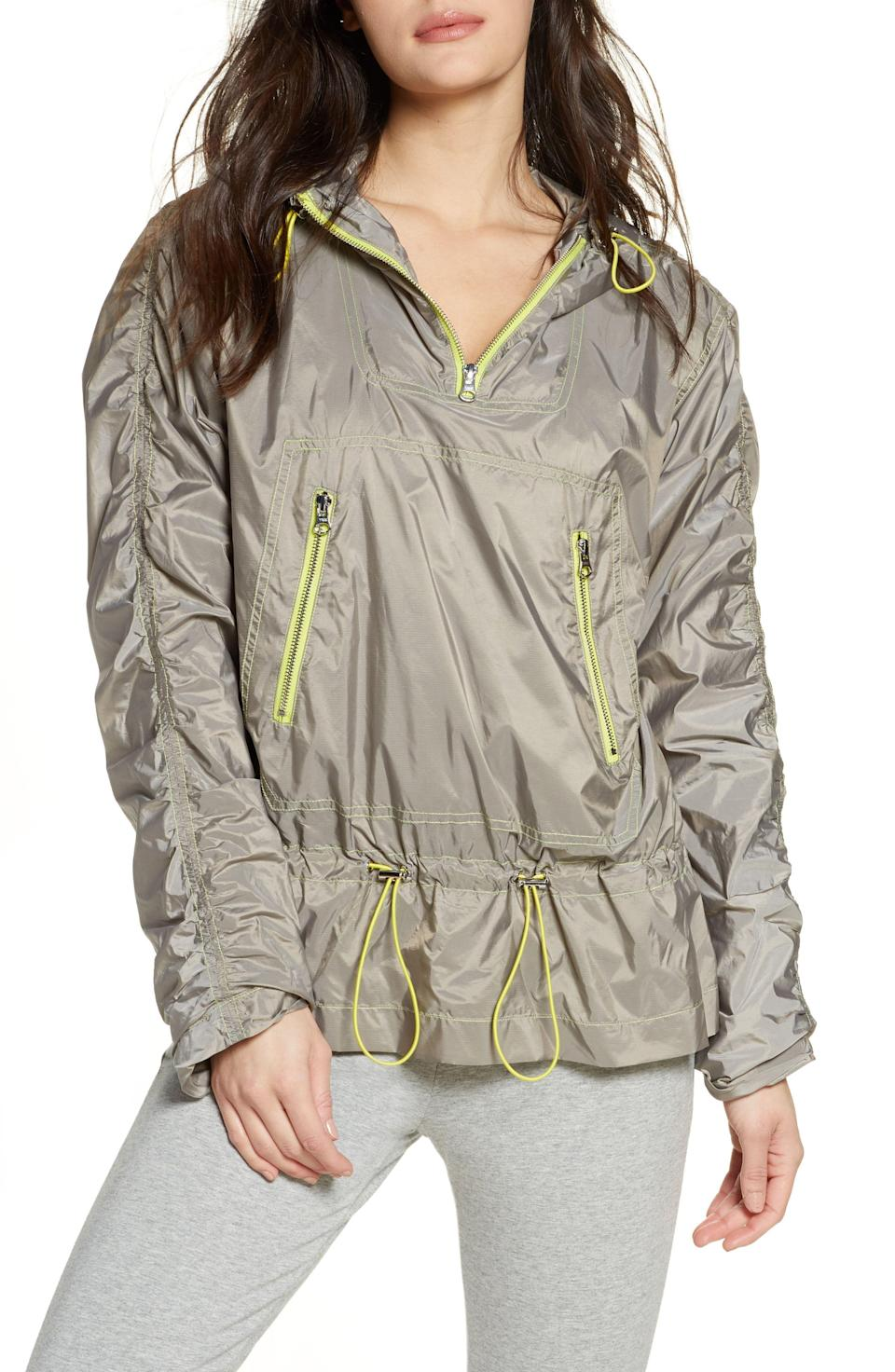 """<p><strong>ZELLA</strong></p><p>nordstrom.com</p><p><strong>$39.98</strong></p><p><a href=""""https://go.redirectingat.com?id=74968X1596630&url=https%3A%2F%2Fshop.nordstrom.com%2Fs%2Fzella-water-resistant-trapeze-anorak%2F5459389&sref=https%3A%2F%2Fwww.goodhousekeeping.com%2Fbeauty%2Ffashion%2Fg32585880%2Frainy-day-outfits%2F"""" rel=""""nofollow noopener"""" target=""""_blank"""" data-ylk=""""slk:Shop Now"""" class=""""link rapid-noclick-resp"""">Shop Now</a></p><p>Wear this water resistant-anorak while running on a drizzly day. It has a hood, zip front pockets, and front toggles to cinch in your waist. </p>"""