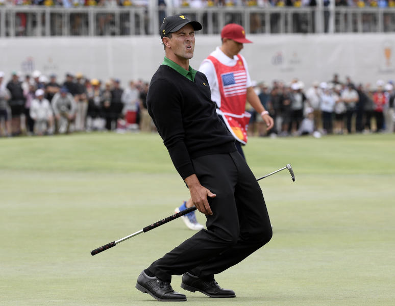 International team player Adam Scott of Australia grimaces after missing a putt on the 16th green in his singles match during the President's Cup golf tournament at Royal Melbourne Golf Club in Melbourne, Sunday, Dec. 15, 2019. (AP Photo/Andy Brownbill)