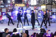 """FILE - Members of BTS perform at the Times Square New Year's Eve celebration in New York on Dec. 31, 2019. The K-pop band is nominated for a Grammy Award for best pop duo/group performance with """"Dynamite,"""" their first song to hit the No. 1 spot on the Billboard Hot 100 chart. (Photo by Ben Hider/Invision/AP, File)"""