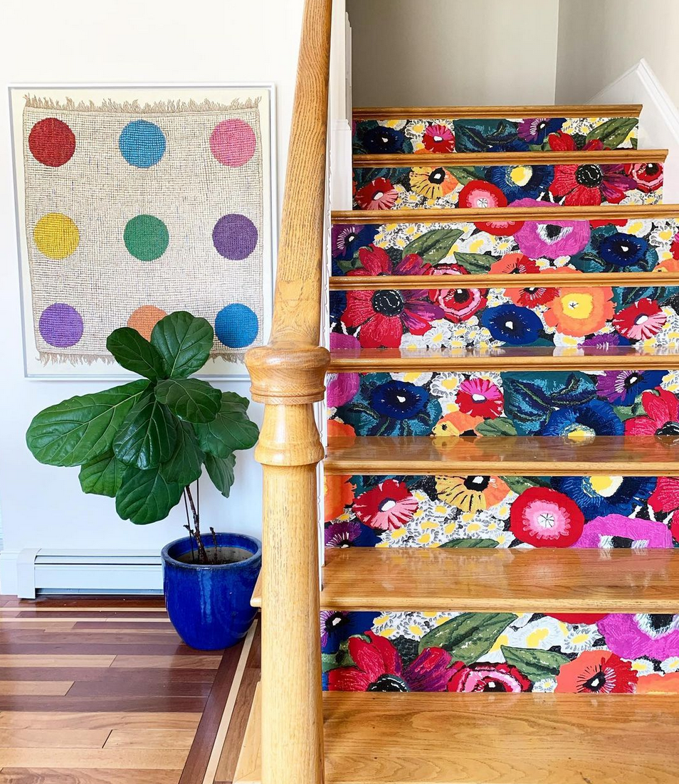 "<p>A simple wooden staircase becomes a statement when you cover the risers in a splashy floral print, like artist <a href=""https://www.instagram.com/p/B-zr78Slfa5/"" rel=""nofollow noopener"" target=""_blank"" data-ylk=""slk:Gina Palaza"" class=""link rapid-noclick-resp"">Gina Palaza</a> did here. She used <a href=""https://go.redirectingat.com?id=74968X1596630&url=https%3A%2F%2Fwww.anthropologie.com%2Fshop%2Fanthropologie-blazing-poppies-wallpaper%3Fcategory%3Dfloral-wallpaper%26color%3D095%26type%3DSTANDARD%26size%3DOne%2BSize%26quantity%3D1&sref=https%3A%2F%2Fwww.thepioneerwoman.com%2Fhome-lifestyle%2Fdecorating-ideas%2Fg35715755%2Fwallpaper-decor-ideas%2F"" rel=""nofollow noopener"" target=""_blank"" data-ylk=""slk:York Wallcoverings paper"" class=""link rapid-noclick-resp"">York Wallcoverings paper</a> from Anthropologie.</p>"