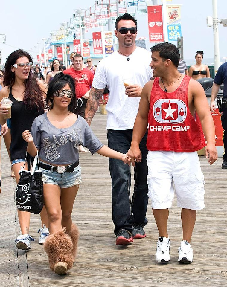 """They're ba-ack! The """"Jersey Shore"""" crew left Italy behind and returned to the place it all began --- Seaside Heights, New Jersey -- to begin shooting Season 5, where Snooki and JWoww reunited with their respective boyfriends, Jionni and Roger. And no, that's not a blindfold Snooki wearing, it's a pair of sunglasses! Eddie Mejia/<a href=""""http://www.splashnewsonline.com"""" target=""""new"""">Splash News</a> - June 28, 2011"""