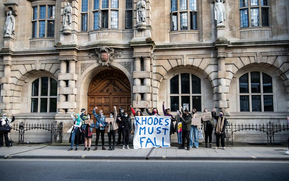 Protesters march to Oriel Colleges statue of Cecil Rhodes at the University of Oxford on May 25, 2021 - Laurel Chor/Getty