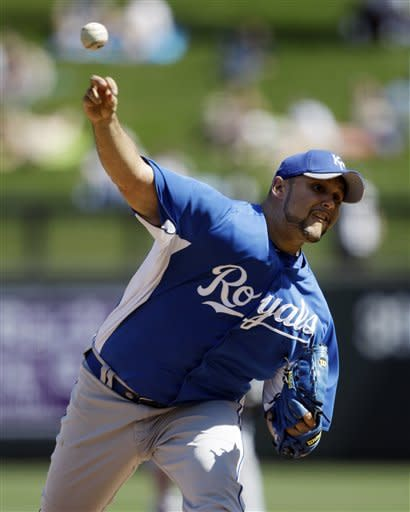 Kansas City Royals starting pitcher Felipe Paulino throws to the Colorado Rockies during the first inning of a spring training baseball game on Thursday, March 8, 2012, in Scottsdale, Ariz. (AP Photo/Marcio Jose Sanchez)