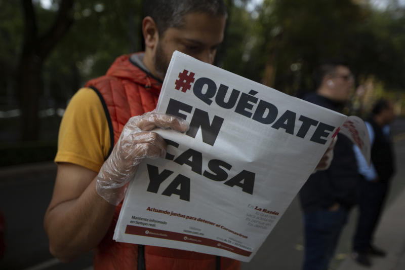 "A man reads a newspaper with the Spanish headline: ""Stay home now"" in Mexico City, Wednesday, April 1, 2020. Mexico's government has broadened its shutdown of ""non essential activities,"" and prohibited gatherings of more than 50 people as a way to help slow down the spread of COVID-19. The one-month emergency measures will be in effect from March 30 to April 30. (AP Photo/Fernando Llano)"
