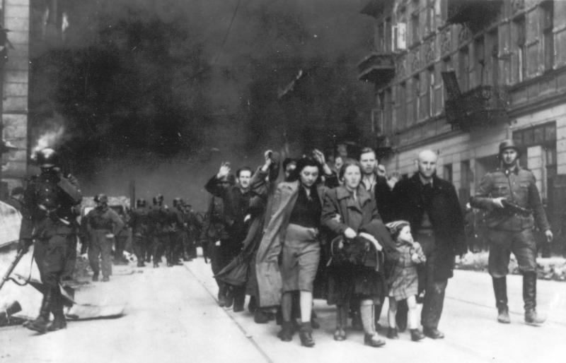 FILE - In this 1943 file photo, a group of Polish Jews are led away for deportation by German SS soldiers during the destruction of the Warsaw Ghetto by  German troops after an uprising in the Jewish quarter. Sixty years after a landmark accord started German government compensation for victims of Nazi crimes, fund administrators and German officials say payments to Holocaust survivors are needed more than ever as they enter their final years. German Finance Minister Wolfgang Schaeuble is to sign off officially Thursday Nov. 15 2012 on revisions to the original 1952 compensation treaty, increasing pensions for those living in eastern Europe and broadening who is eligible for payments. (AP Photo, file)