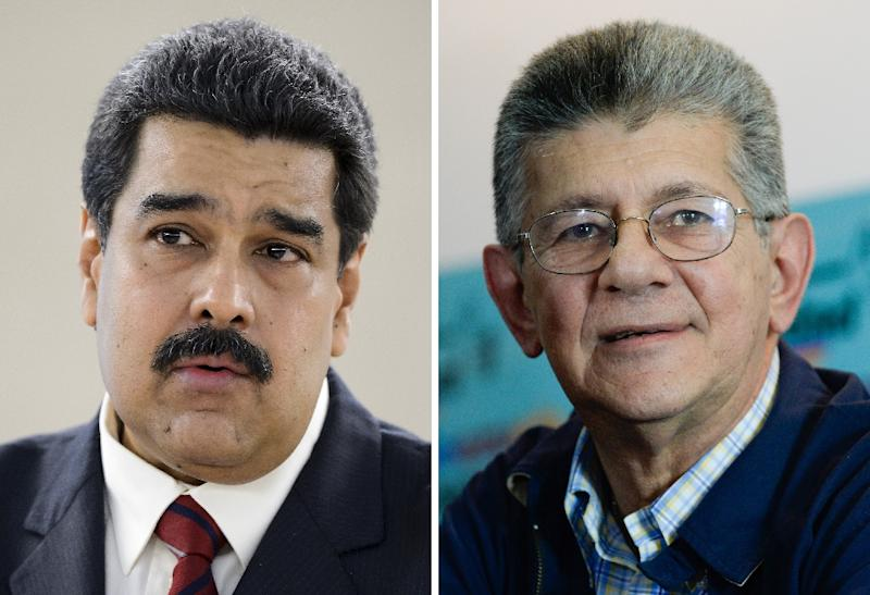 Venezuelan President Nicolas Maduro (L) and Henry Ramos Allup (R), a fiery Maduro opponent who suspended the session of the opposition-controlled National Assembly (AFP Photo/)