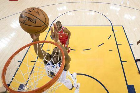 May 20, 2018; Oakland, CA, USA; Golden State Warriors forward Andre Iguodala (9) shoots the basketball against Houston Rockets guard Chris Paul (3) during the first half in game three of the Western conference finals of the 2018 NBA Playoffs at Oracle Arena. The Warriors defeated the Rockets 126-85. Mandatory Credit: Kyle Terada-USA TODAY Sports