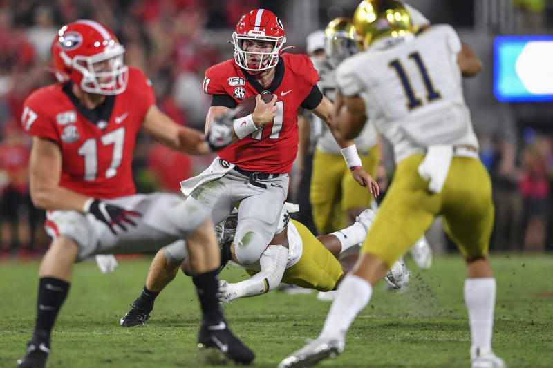 Sep 21, 2019; Athens, GA, USA; Georgia Bulldogs quarterback Jake Fromm (11) runs against the Notre Dame Fighting Irish during the second half at Sanford Stadium. Mandatory Credit: Dale Zanine-USA TODAY Sports