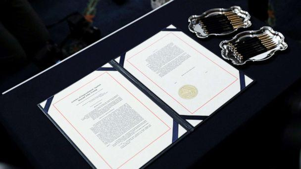 PHOTO: The two U.S House of Representatives articles of impeachment of President Donald Trump await the signature of House Speaker Nancy Pelosi before an engrossment ceremony at the U.S. Capitol in Washington, Jan. 15, 2020. (Leah Millis/Reuters)