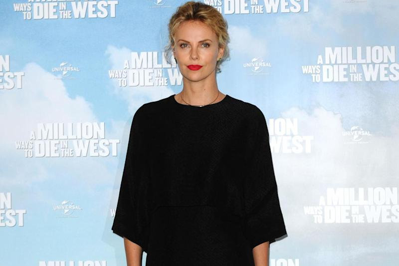 Charlize Theron says she is raising her child as a girl: 'It is not for me to decide'
