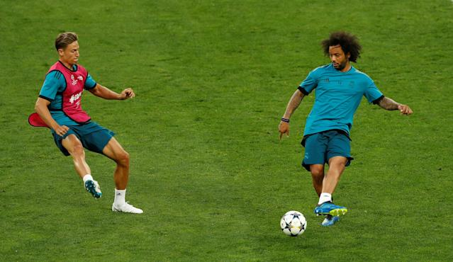 Soccer Football - Champions League Final - Real Madrid Training - NSC Olympic Stadium, Kiev, Ukraine - May 25, 2018 Real Madrid's Marcelo and Marcos Llorente during training REUTERS/Andrew Boyers