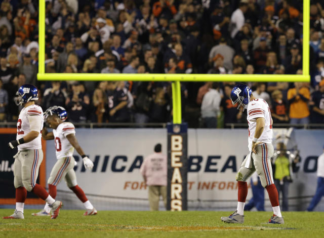 New York Giants quarterback Eli Manning (10) walks to the sideline after throwing an interception in the fourth quarter of an NFL football game against the Chicago Bears, Thursday, Oct. 10, 2013, in Chicago. The Bears won 27-21. (AP Photo/Nam Y. Huh)