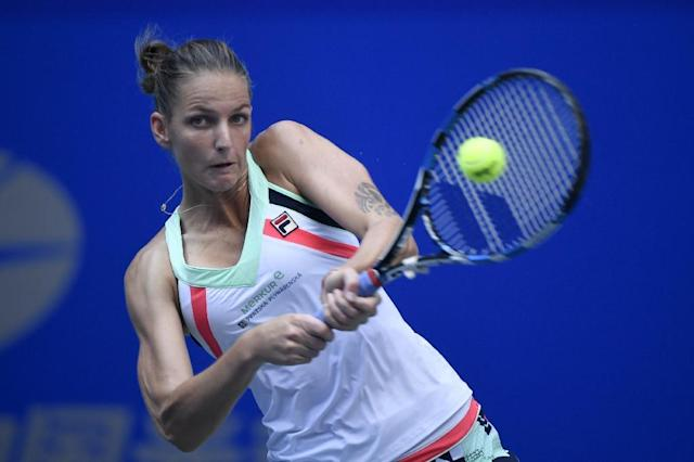 Czech's Karolina Pliskova hits a return against Shuai Zhang of China during their second round women's singles match at the WTA Wuhan Open tennis tournament on September 26, 2017 (AFP Photo/WANG ZHAO)
