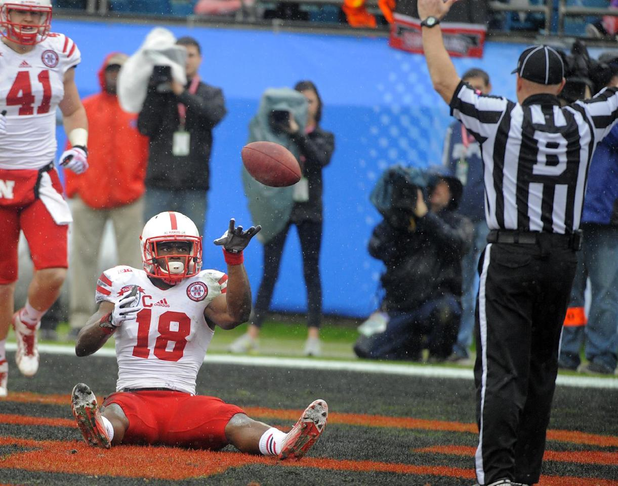Nebraska wide receiver Quincy Enunwa (18) tossed the ball to an official after scoring a touchdown during the first half of the Gator Bowl NCAA college football game against Georgia, Wednesday, Jan. 1, 2014, in Jacksonville, Fla. (AP Photo/Stephen B. Morton)