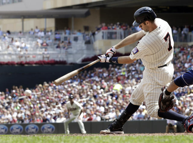 Minnesota Twins' Joe Mauer hits a two-run, bases loaded single in the sixth inning of a baseball game off Cleveland Indians' pitcher Rich Hill, Wednesday, Aug. 14, 2013 in Minneapolis. (AP Photo/Jim Mone)