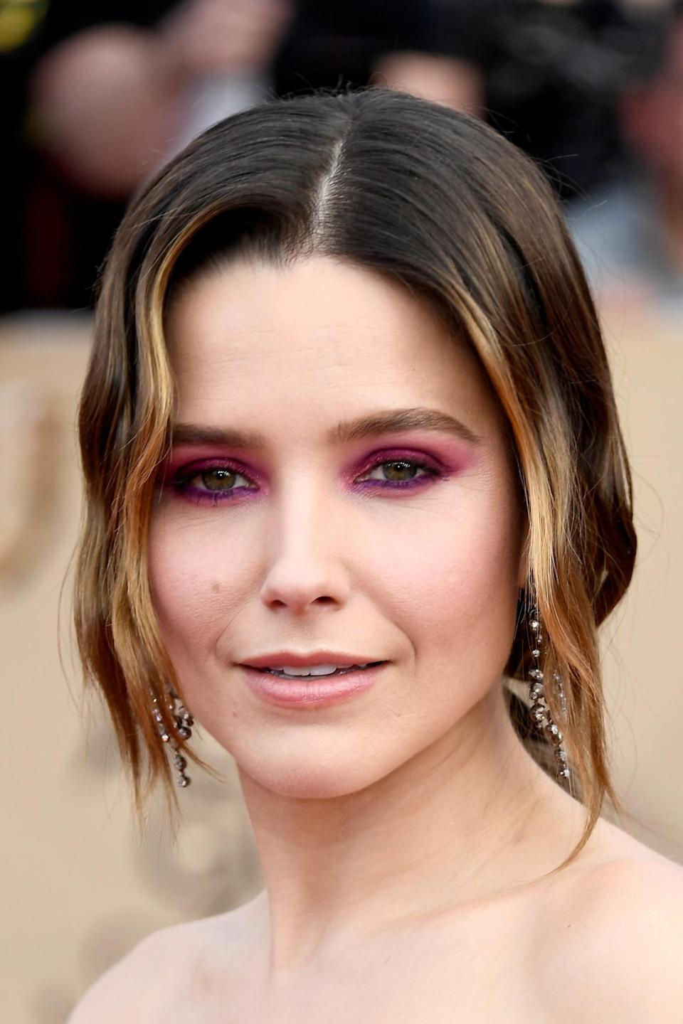 <p>Sophia went for a bold beauty statement, opting for bright pink eyeshadow to match her hot pink dress and it definitely paid off. [Photo: Getty] </p>
