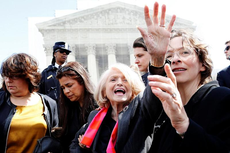 Edith Windsor greets the crowd outside after arguments in her case against the Defense of Marriage Act at the US Supreme Court in 2013 (REUTERS)