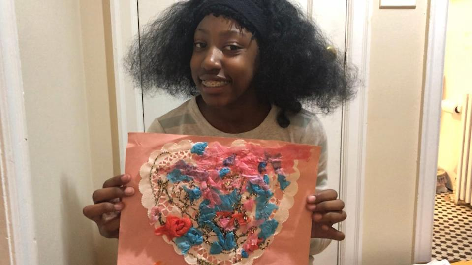 Shirley Profit holds a work of art she created while she was attending High Road schools in Connecticut for students with disabilities. In total, over five years, High Road staff restrained Shirley at least 96 times and put her in seclusion 146 times.
