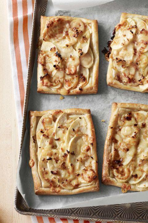 "<p>It may seem unexpected, but ooey gooey Gruyère cheese perfectly complements crisp fall apples.</p><p><strong><a href=""http://www.womansday.com/food-recipes/food-drinks/recipes/a37374/savory-gruyere-apple-tarts-recipe-clv0911/"" rel=""nofollow noopener"" target=""_blank"" data-ylk=""slk:Get the recipe"" class=""link rapid-noclick-resp"">Get the recipe</a>.</strong></p>"
