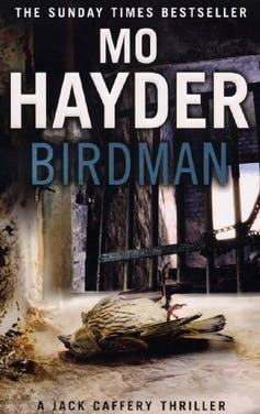 Book cover shows dead bird with metal window bars in the background.