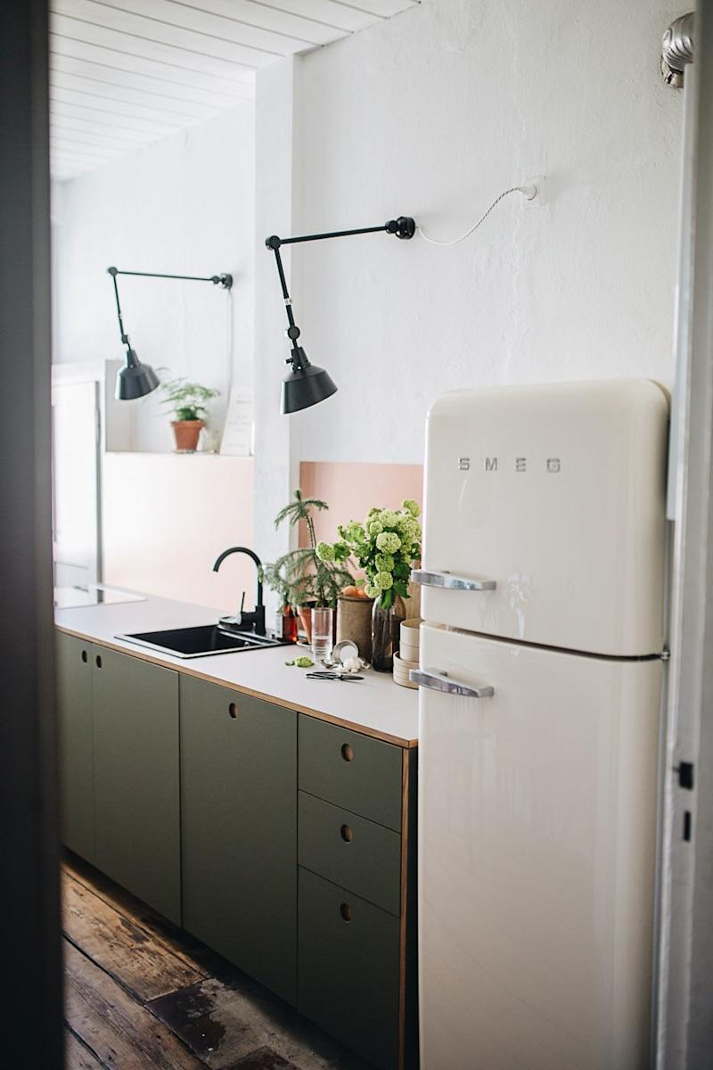 Office-style modular wall lamps make a quirky addition to the kitchen.
