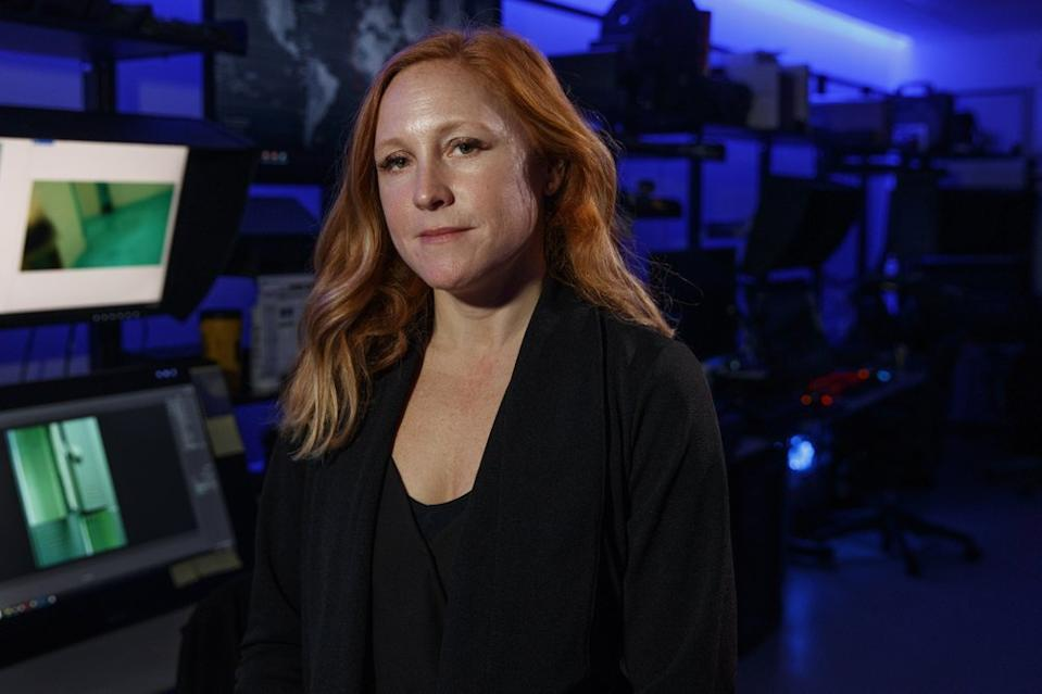 Erin Burke, Section Chief of the Child Exploitation Investigations Unit at Homeland Security, poses for a portrait inside the Victim Identification Lab, part of Homeland Security's Child Exploitation Investigations Unit, in Fairfax, Va., Friday, Nov. 22, 2019. The Homeland Security Investigations section's little-known Child Exploitation Investigations lab is where agents scour disturbing photos and videos of child sexual abuse. They look for unlikely clues that help them identify the children and bring their abusers to justice. In one case, it was the loud, persistent chirping of a bird. Another time, it was unusual playground equipment. (AP Photo/Jacquelyn Martin)