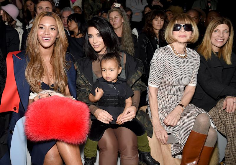 Beyonce, Kim Kardashian with daughter North and Anna Wintour attend the adidas Originals x Kanye West YEEZY SEASON 1 fashion show during New York Fashion Week Fall 2015 at Skylight Clarkson Sq on February 12, 2015 in New York City. (Photo by Dimitrios Kambouris/Getty Images for adidas)
