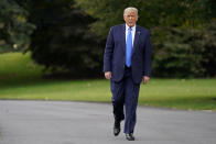 President Donald Trump walks to speak to members of the press on the South Lawn of the White House in Washington, Thursday, Sept. 24, 2020, before boarding Marine One for a short trip to Andrews Air Force Base, Md. Trump is traveling to North Carolina and Florida. (AP Photo/Patrick Semansky)