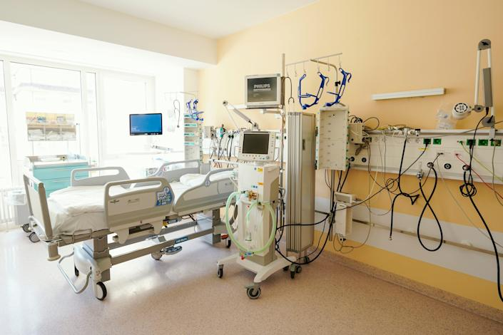 A bed with a ventilator in an intensive-care unit.